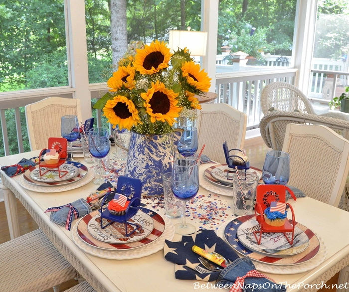 4th of July Table with Warren Kimble Flag Dishware and Sunflower Centerpiece