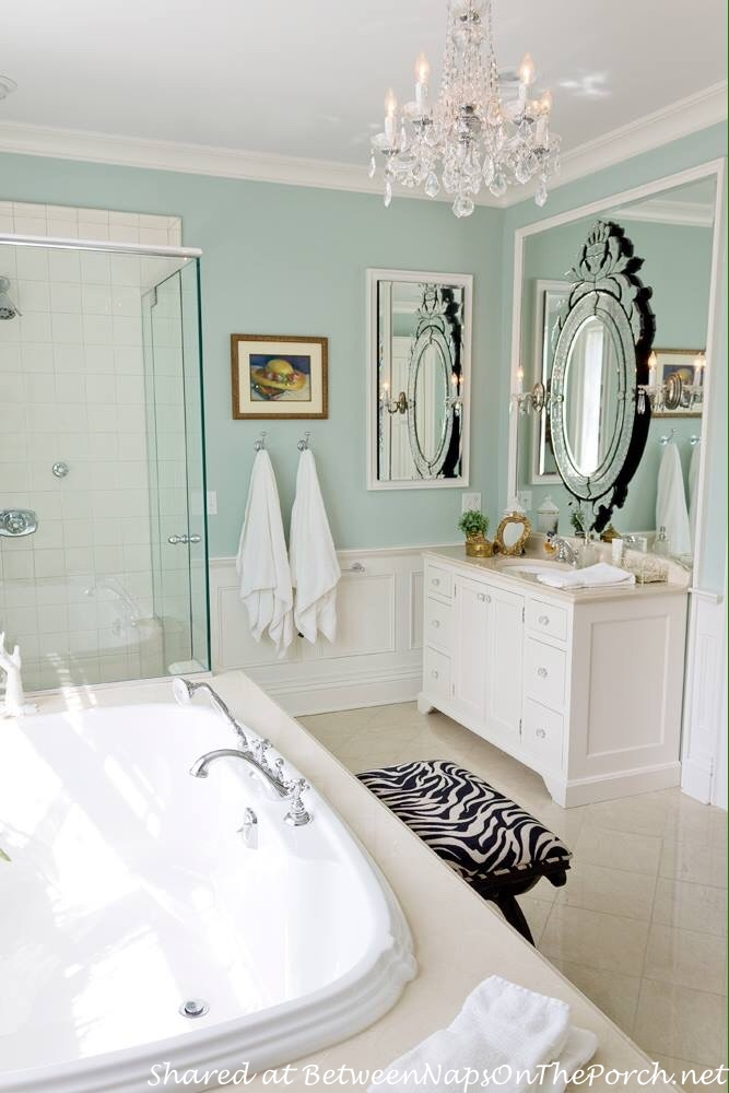 Bath with chandelier and Venetian Glass Mirror
