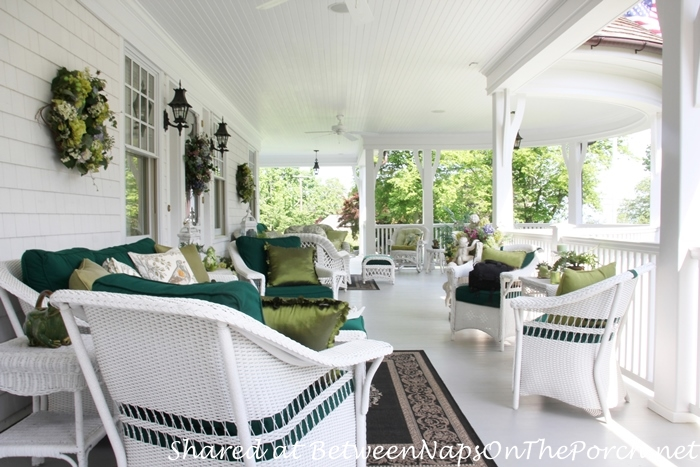 Victorian Porch With White Wicker Furniture