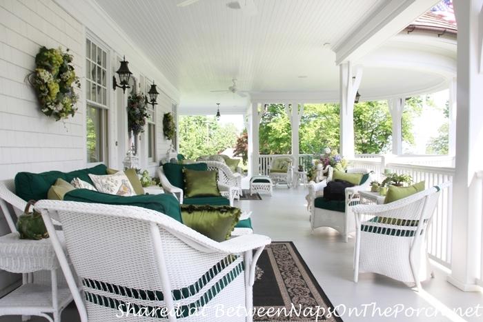 Victorian Porch With White Wicker Furniture