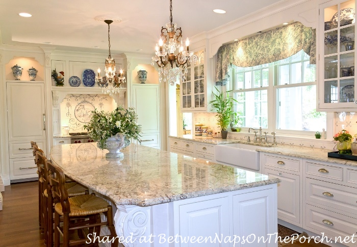 White Kitchen with Granite Counters & Chandeliers