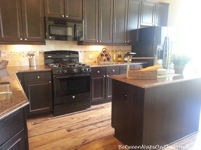 Kitchen with Black Cabinets and Beautiful granite