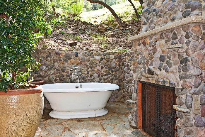 Outdoor Bathtube with Stone Fireplace