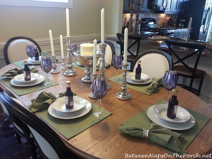 Table Setting in green and purple with Silver Candlesticks