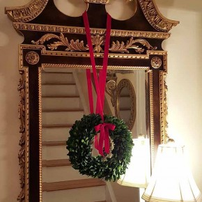 Boxwood Wreath Hanging From Mirror