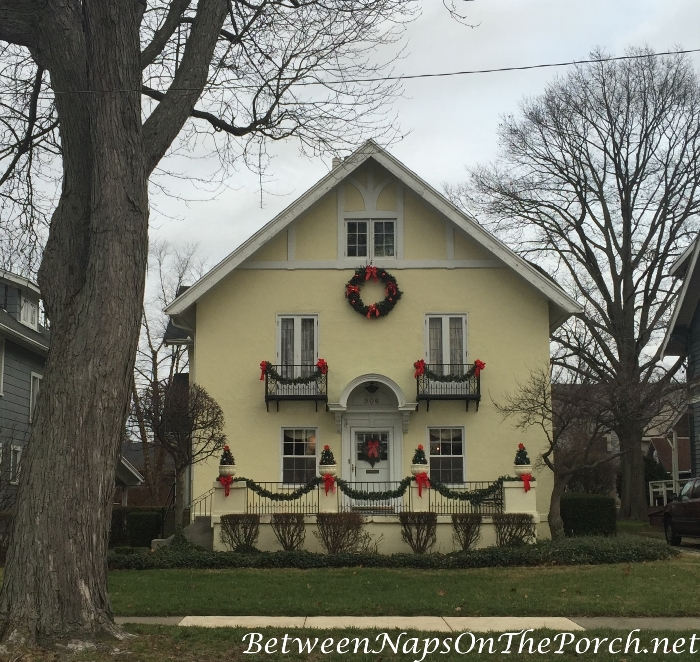 Christmas Decorations on Yellow Tudor Style Home