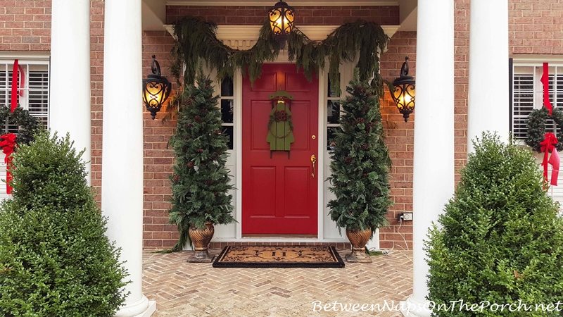 Christmas Porch with Red Door and Cedar Garland