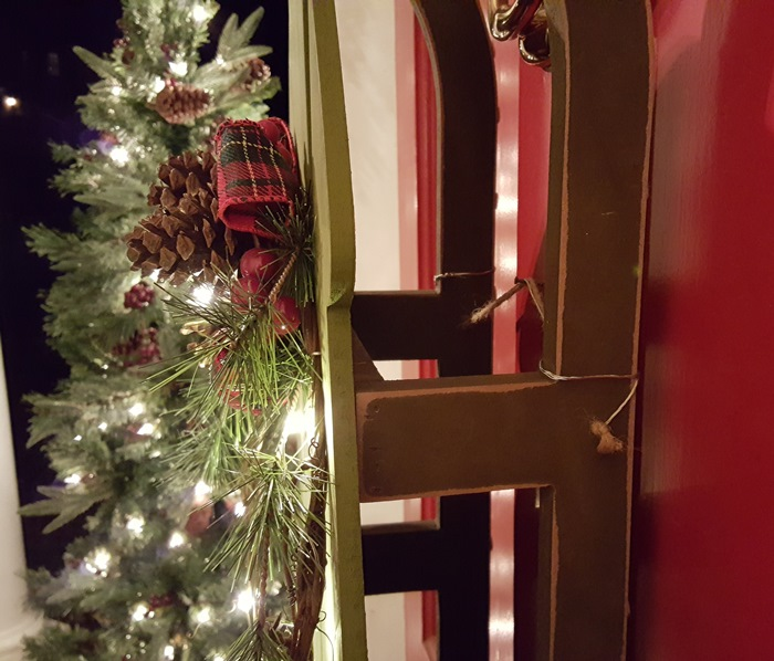 Sled on door for Christmas
