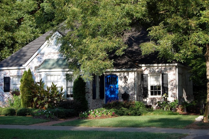 Painted Brick Cottage with Bright Blue Door