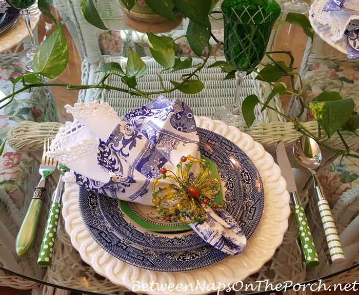 Blue and White Table Setting with Green Stemware and Flatware