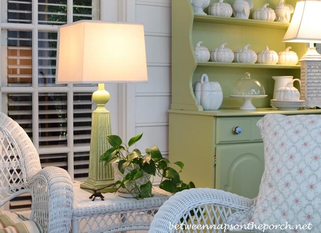 Green & White Porch Decorated in White Wicker