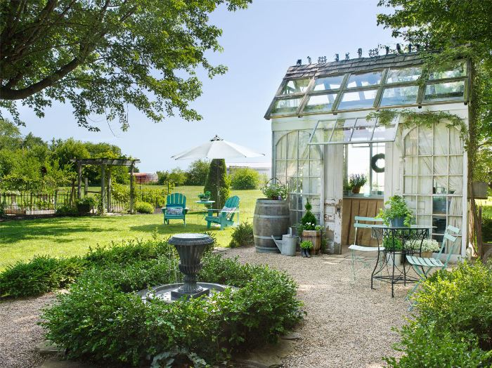 Boxwoods encircle a fountain, Beautiful Greenhouse-Garden Shed