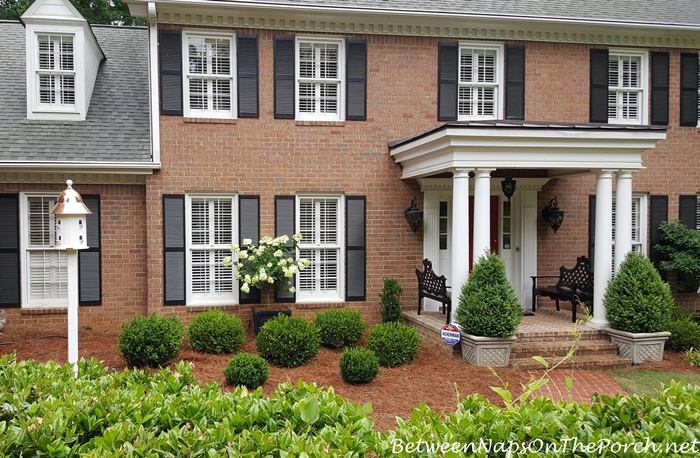 A Front Yard Makeover With Boxwood Shrubs Benches Copper Roof Dovecote Between Naps On The Porch
