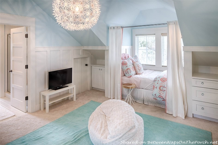 Charming attic bedroom with wainscoting and built-in beds_wm