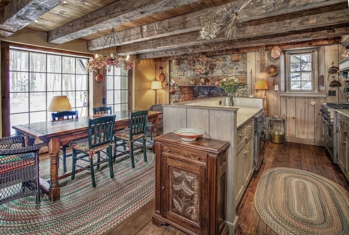 Cozy Kitchen with Wood Beam Ceiling in The Tory House