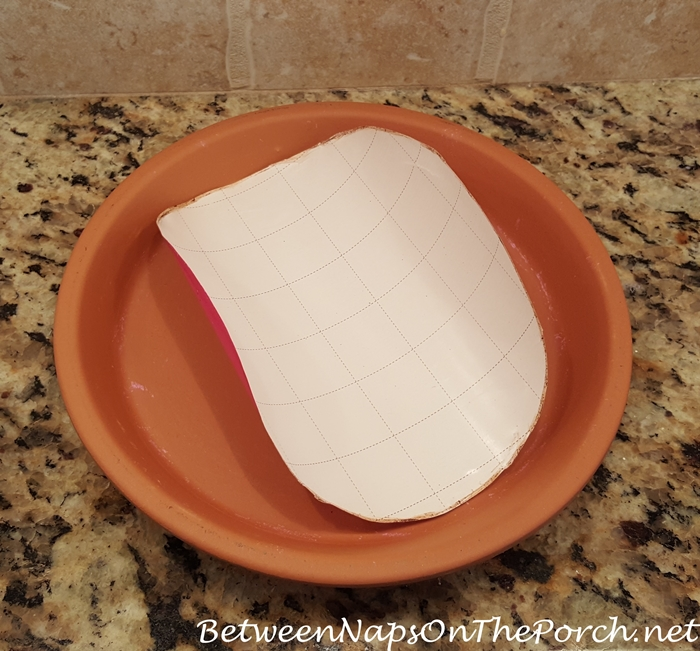 Easy way to find center of terra cotta clay saucer
