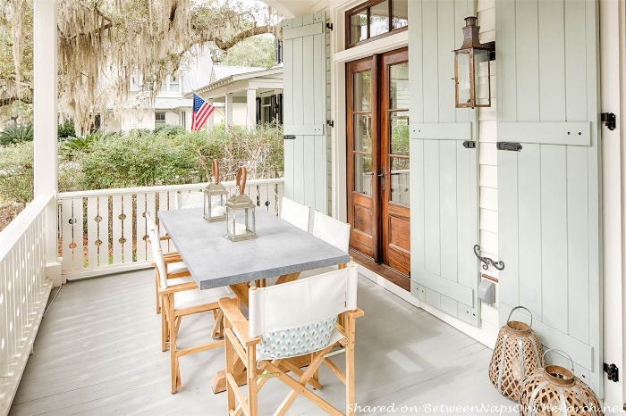 Front Porch with Outdoor Trestle Style Table_wm