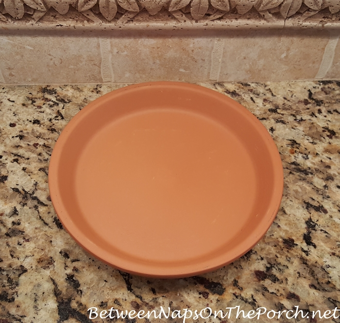 How to find the center of a terra cotta saucer