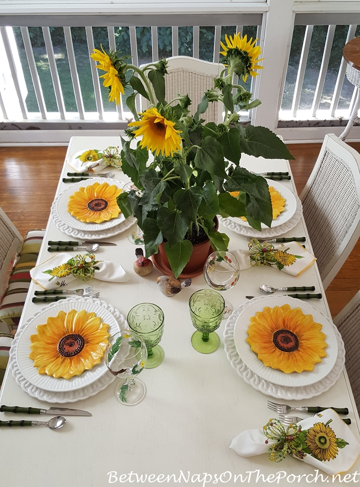 Spring table with sunflower centerpiece plates