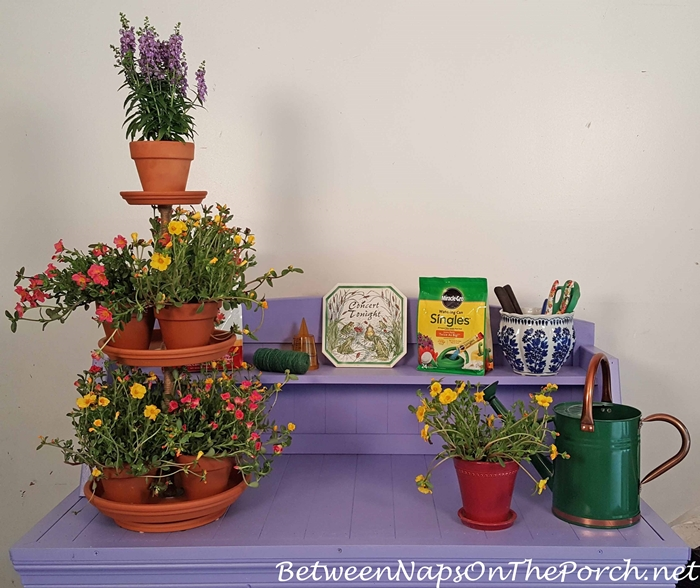 Tiered Clay Planter on Periwinkle Potting Bench