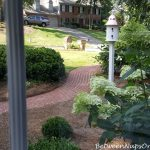 A Front Yard Makeover With Boxwood Shrubs, Benches & Copper-Roof Dovecote