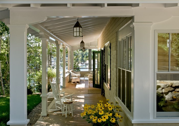 Spacious Front Porch with Lanterns and Shed Style Roof