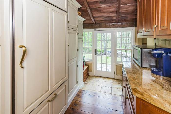 Hidden Refrigerator Behind Cabinetry