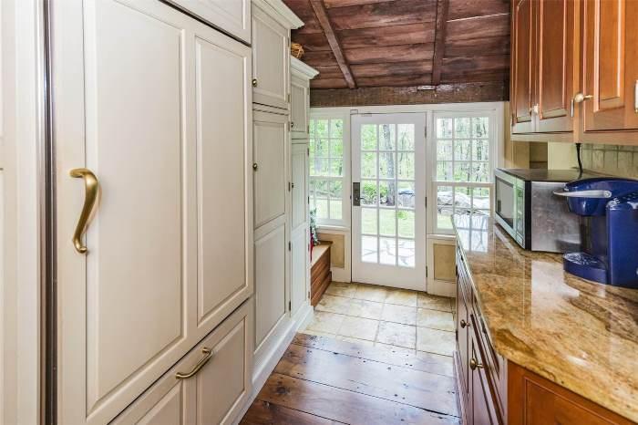 Hidden Refrigerator Behind Cabinetry