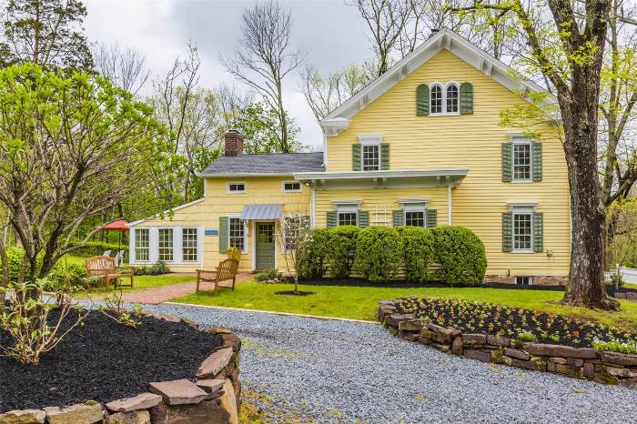Historic Yellow Home with Green Shutters