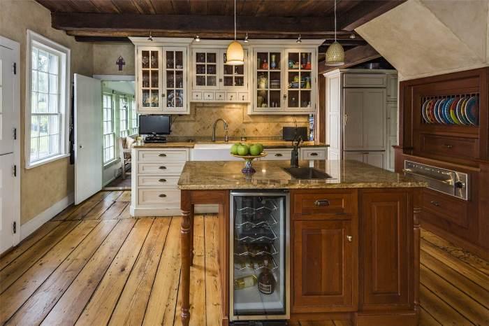 Kitchen with White Cabinets, Wood Cabinets, Granite Counters, Warming Drawer, Viking Range, Hidden Refrigerator, Pumpkin Pine Flooring, Historic Home