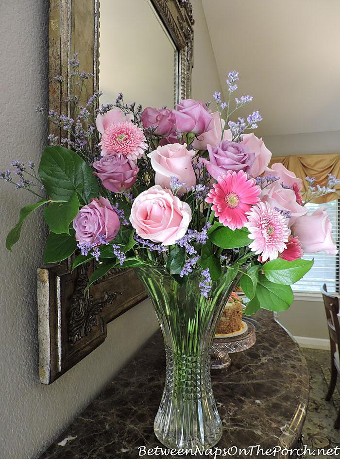 Pink Titanic Roses, Gerbera Daisy, Lavender Limonium and Lemon Leaf