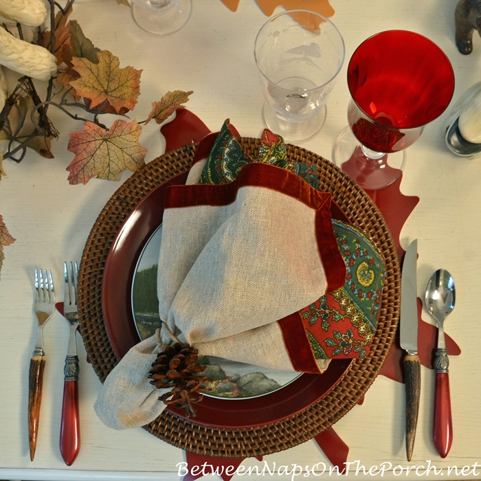 brown-woven-chargers-and-paisley-napkins-for-a-fall-table-setting