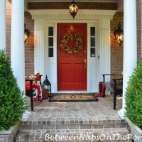 Create An Autumn Porch That Will Invite Guests To Linger