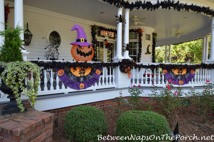 decorate-porch-with-halloween-garland-and-banners