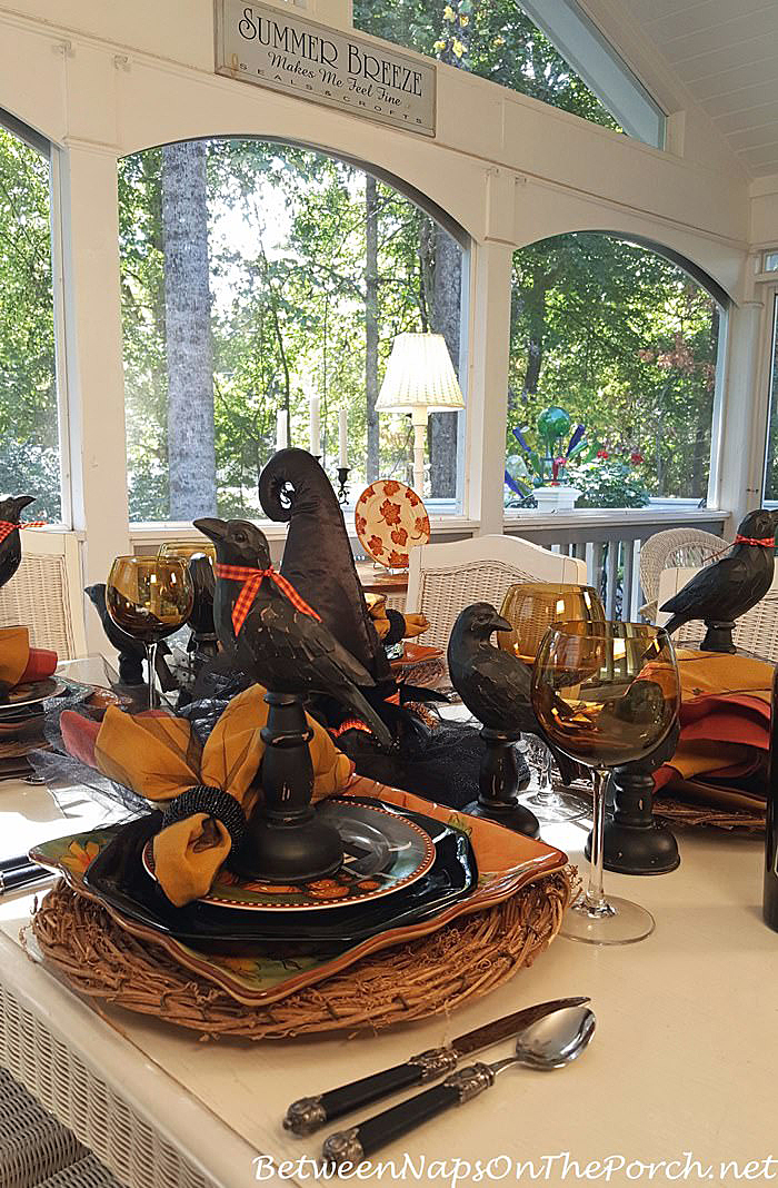 the crows at each place setting dressed up for the occasion wearing their finest bow ties - Halloween Place Settings