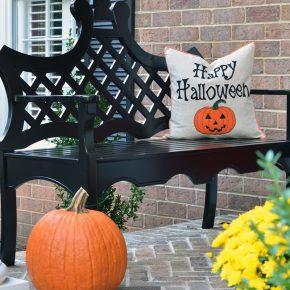 happy-halloween-pillow-on-black-bench