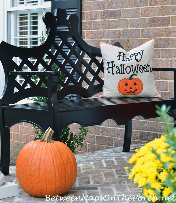 happy-halloween-pillow-on-black-bench