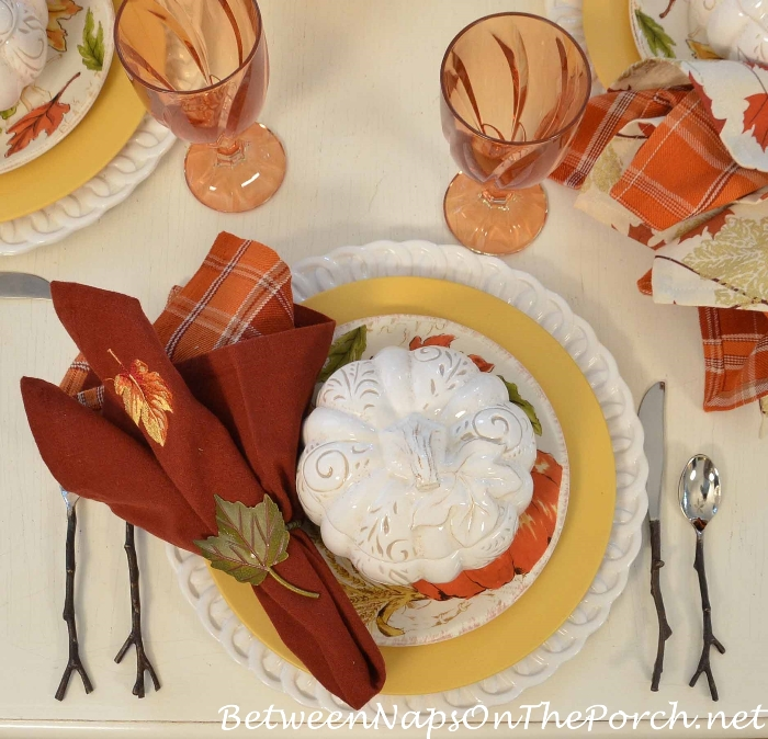 orange-plaid-napkin-leaf-napkin-white-pumpkin-tureen-twig-flatware-amber-glass-yellow-dinner-plate