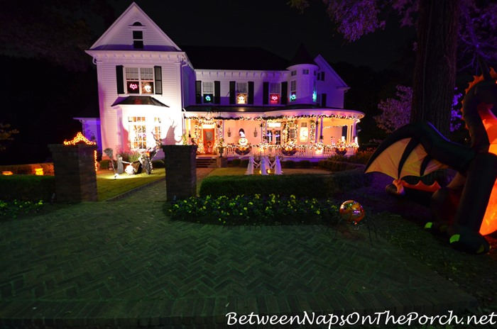 victorian-home-lit-at-night-for-halloween