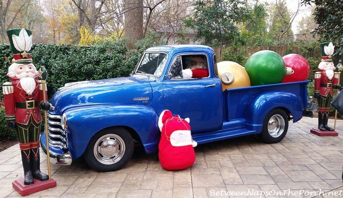 antique-blue-chevrolet-truck-santa-driving
