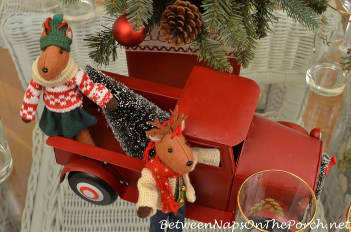 red-christmas-truck-bringing-home-tree