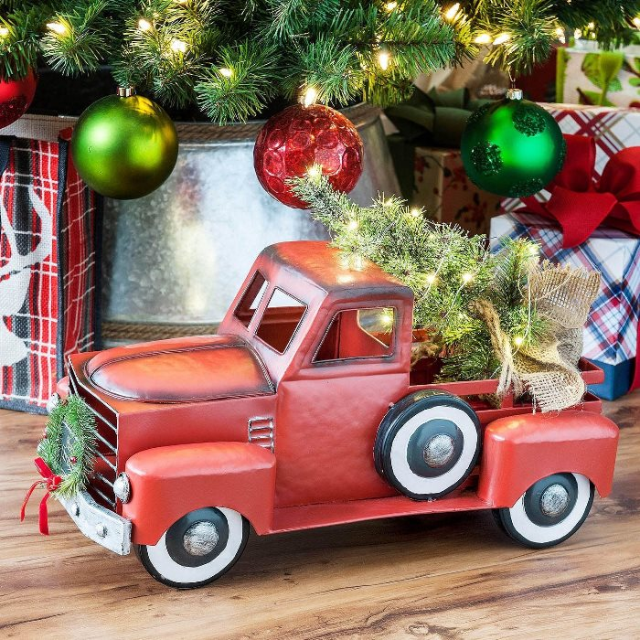 Red Christmas Truck And Station Wagon With Lit Tree And