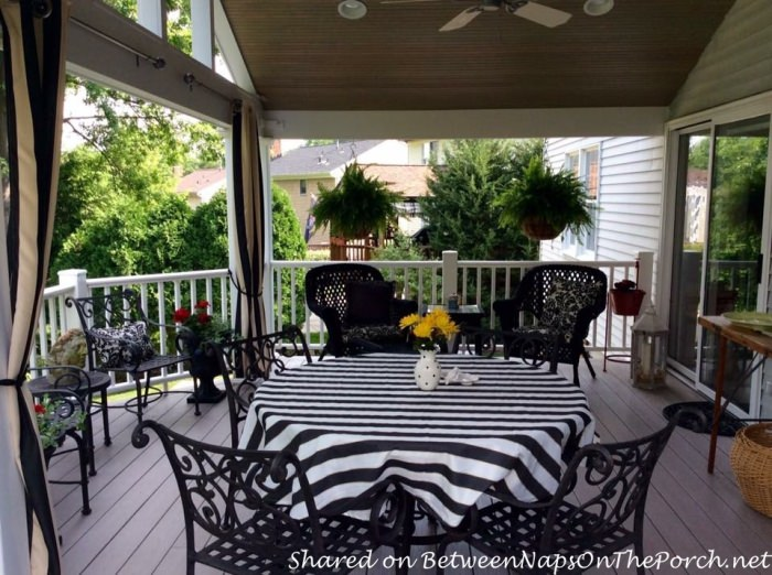 Porch with Black Wicker and Black Wrought Iron Chairs