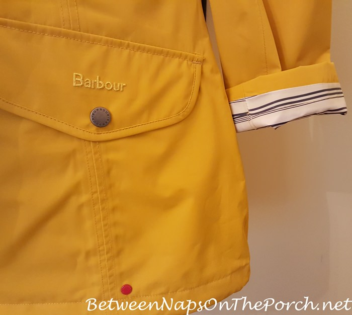 Yellow Barbour Trevose Waterproof Jacket, Striped Lining Visible with Sleeve Turned Up