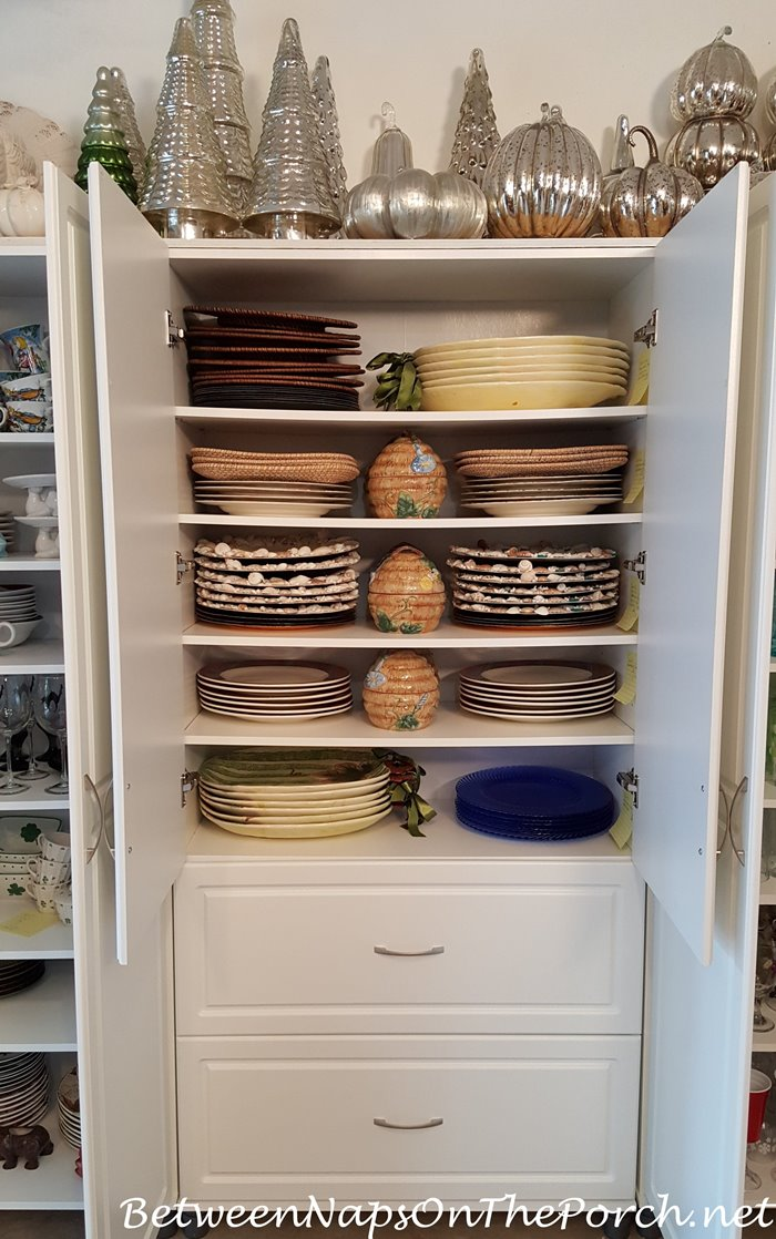 Charger Plates Stored in White Cabinet, Napkin Storage Below