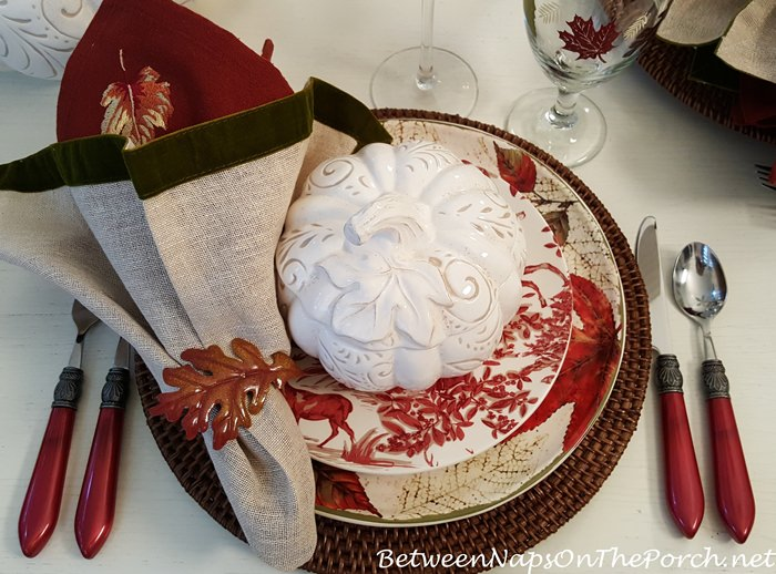 A Fall Table with Pumpkin Soup Tureens and Autumn Leaf Dinnerware