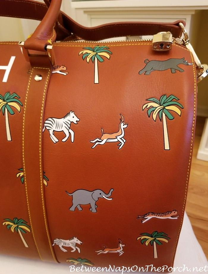 Embossed Safari Animals on Very Troubled Child Darjeeling Limited Safari Bag