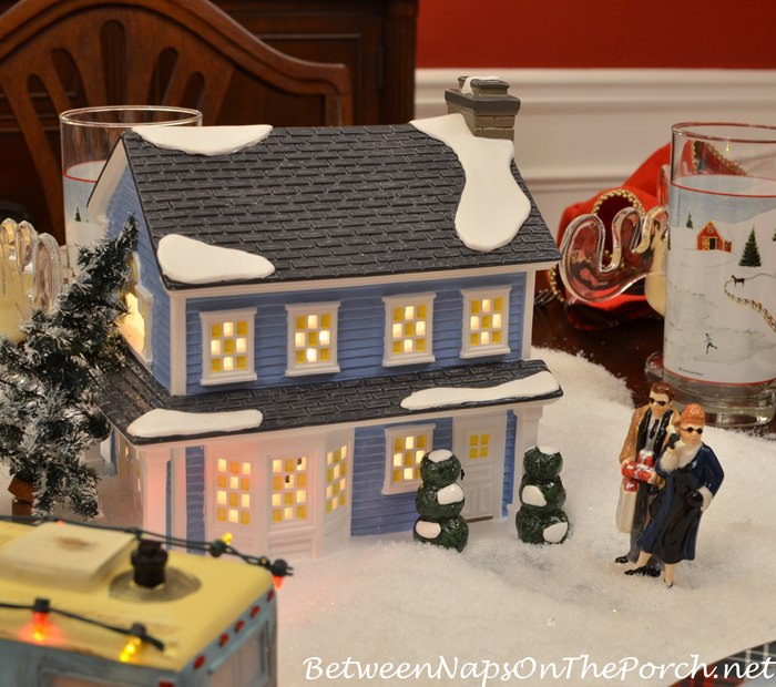 A Christmas Vacation Table Setting With Department 56 Lit