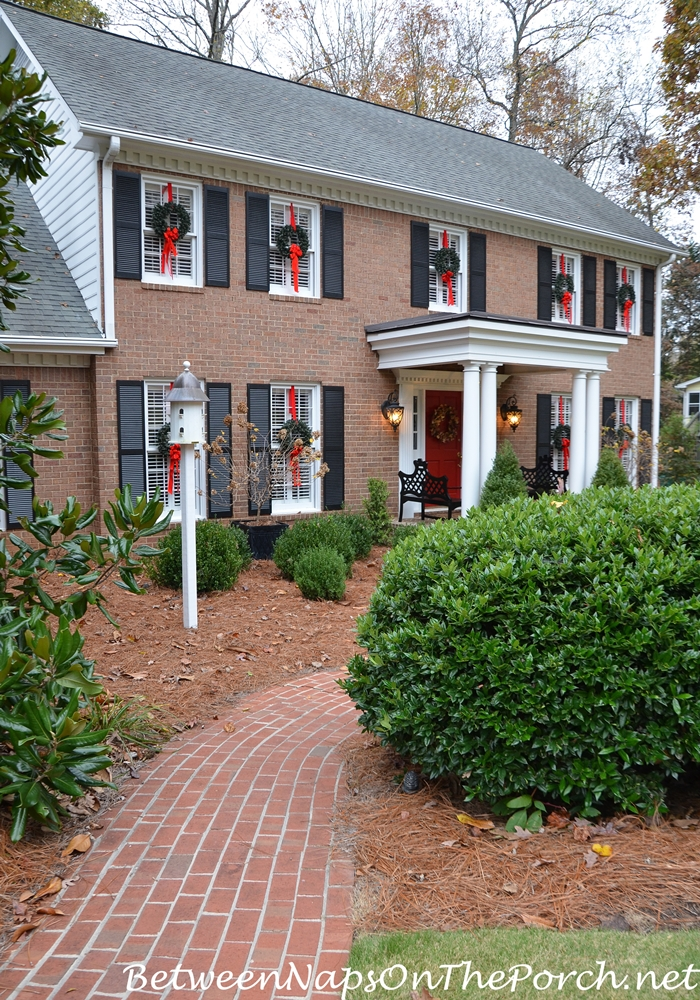 Hanging Wreaths on Exterior Windows, Brick Walkway