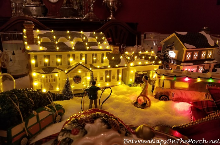 nighttime view of christmas vacation dept 56 lit houses